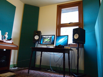 corner bass traps and acoustic wall panels in home studio